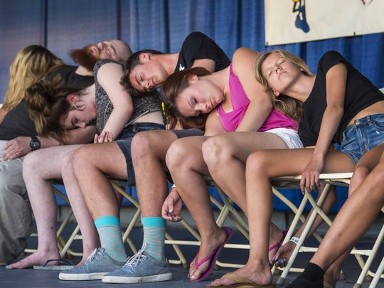 Volunteers slumber on stage during the Steve Bayner hypnotism show on the opening day of the Champlain Valley Fair in Essex Junction on Friday, August 26, 2016. Bayner returns for performances each day this year.