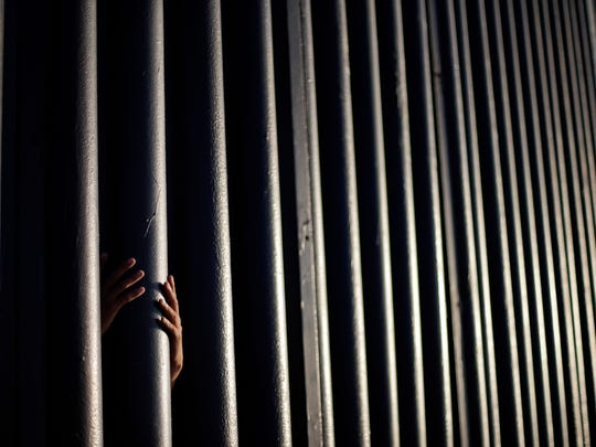 In this June 13, 2013  photo, Daniel Zambrano, of Tijuana, Mexico, holds one of the bars that make up the border wall separating the U.S. and Mexico where the border meets the Pacific Ocean in San Diego. Presumptive GOP nominee Donald Trump's push for a border wall is not a new idea, and since World War I, has been pursued often. Historians say opponents of Mexican immigration have advocated for a wall off and on for about 100 years with little results due to changing technologies and pressure to divert enforcement attention elsewhere.