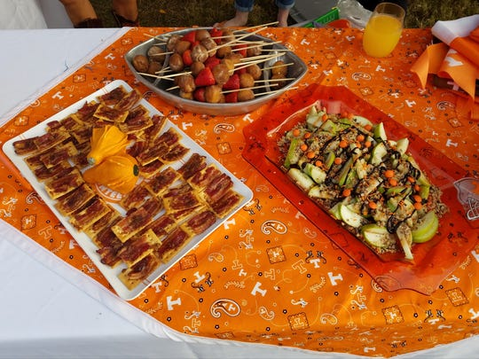 A sampling of foods from Alison Turner's tailgate on Saturday, Oct. 14, 2017. They include, from left, brown sugar bacon bites on crackers, kebabs with strawberries and pumpkin spice donuts and apple nachos.