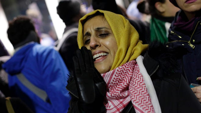 A woman yells as she protests President Trump's executive immigration ban at O'Hare International Airport on Jan. 29, 2017 in Chicago.