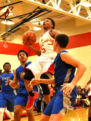 North College Hill's Lorenzo Sparks finds the basket and narrows thee Summit lead for the Trojans, Feb. 2, 2018.