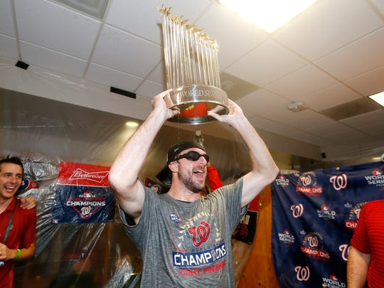 HOUSTON, TEXAS - OCTOBER 30:  Max Scherzer #31 of the Washington Nationals celebrates in the locker room after defeating the Houston Astros in Game Seven to win the 2019 World Series at Minute Maid Park on October 30, 2019 in Houston, Texas. The Washington Nationals defeated the Houston Astros with a score of 6 to 2. (Photo by Elsa/Getty Images)