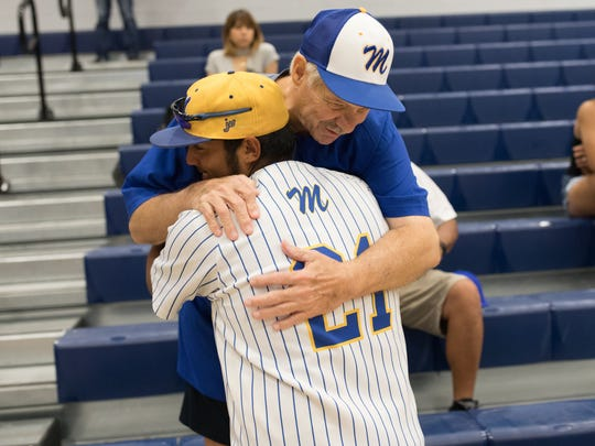 Moody's Ramsey Flores hugs fan David White before their pep rally Tuesday before heading to Round Rock for the state tournament.