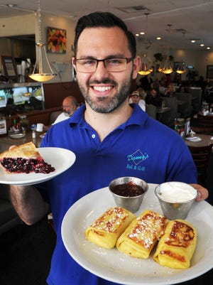 Alex Everhart, co-owner of Danny's Deli & Grill in Ventura, displays cheeze blintzes with strawberry jam and a slice of boysenberry pie.
