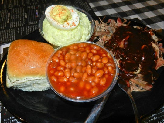 The Commissary's Kathy Bates' Special: BBQ Pulled Pork, ribs, BBQ Beans and Potato Salad topped with a Deviled Egg