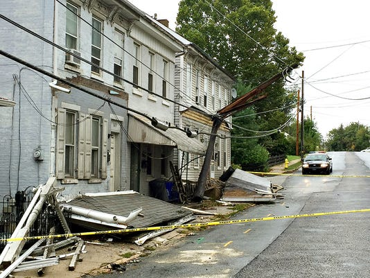 An electric pole and several homes were damaged when a driver lost control and veered into homes in the 1600 block of Mt. Rose Avenue in Spring Garden Township in York, Pa. on Saturday, Oct. 3, 2015. Dawn J. Sagert - dsagert@yorkdispatch.com