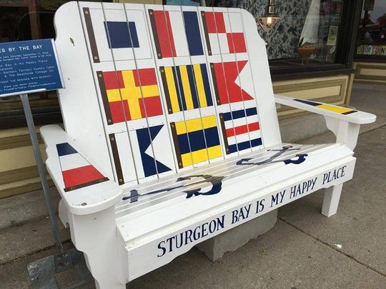"""""""Sturgeon Bay is My Happy Place"""" by Suzi Derenne, one of the artist-decorated benches available to bidders in the Sept. 17 Harvest Festival and Street Art Auction in Sturgeon Bay."""