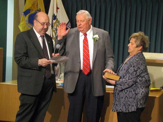 Sinning, joined by his wife, Bernice, is sworn in by Mayor Richard Goldberg to serve another four-year term on the Borough Council in 2016.