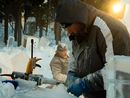 Brian McKinney of Great Falls and Jeff Kaiser of Pennsylvania work on their entry for the Ice Alaska world ice sculpting competition in Fairbanks, Alaska.