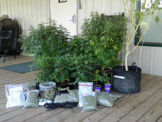Marijuana and paraphernalia seized from the residence of Jon Ryan Temple, 32, of Mansfield, arrested Thursday on multiple drug charges after a school resource officer smelled marijuana on the backpacks of juvenicles living there.
