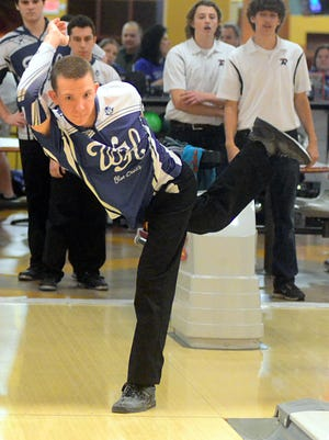 White House High junior John Wright rolled a 223 in the second game of the District 13 championship match against Creek Wood.
