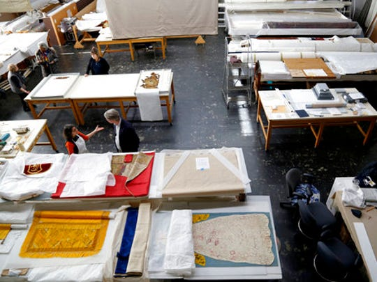 """Conservation projects are in progress in the Textile Conservation Laboratory at the Cathedral of St. John the Divine in New York, Wednesday, March 22, 2017. Experts at the cathedral just spent 16 years sprucing up its super-size wall hangings with a labor-intensive process that uses dental probes, tweezers and other tools. Now the historic house of worship is inviting the public to enjoy the fruits of its labors. An exhibit called """"The Barberini Tapestries, Scenes from the Life of Christ"""" runs through June 25."""