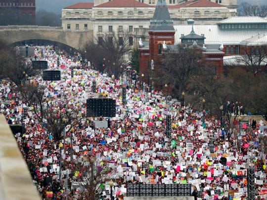 FILE - In this Jan. 21, 2017 file photo, a crowd fills Independence Avenue during the Women's March on Washington, in Washington. The major protests in Washington that have greeted President Donald Trump's first year in office are set to return in force, continuing an already expensive year for city officials who work to keep people safe during mass gatherings.