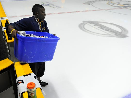 Malik Johnson works as an equipment assistant for the Nashville Predators at Bridgestone Arena on Oct. 10, 2015.