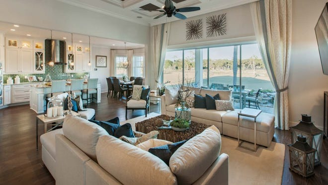 Azure at Hacienda Lakes is offering a San Giorgio home design, like the one shown, which includes a great room with access to the covered lanai through pocketing sliding doors.