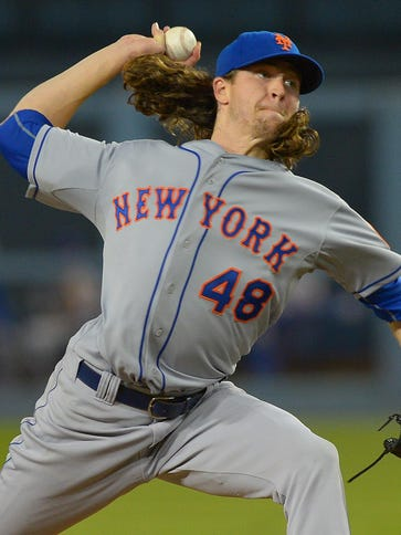 Jacob deGrom struck out 13 in his postseason debut.