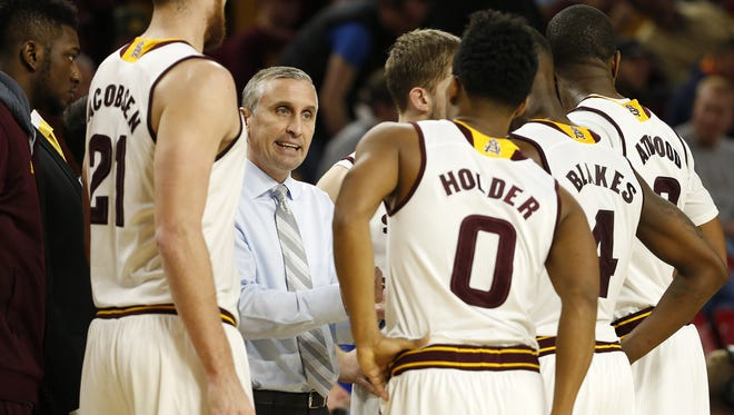 ASU head coach Bobby Hurley talks to his team during a break with Stephen F. Austin during the second half at Wells Fargo Arena in Tempe, Ariz. December 22, 2015.