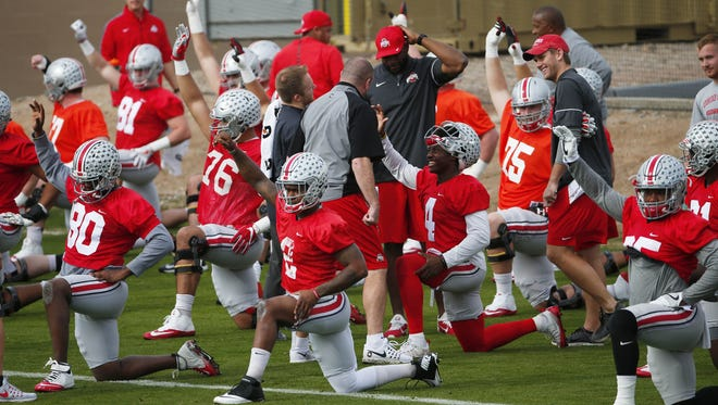 Ohio State players stretch during practice at Notre Dame Preparatory High School in Scottsdale, Ariz. , on Dec.  28, 2016. Ohio State will play Clemson in the Fiesta Bowl National Semifinal game.