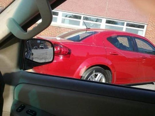 A man accused of performing a lewd act in public drove off in this red car, believed to be a Dodge Charger or Avenger.