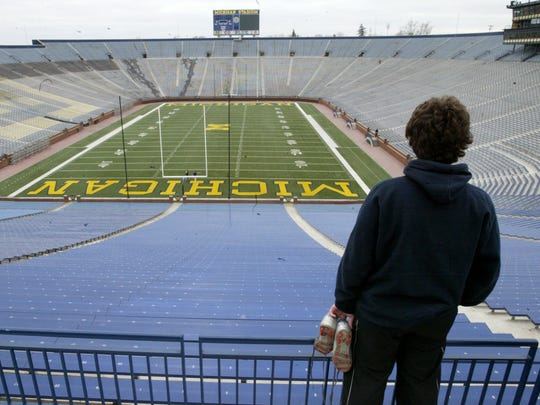 A University of Michigan student looks at an empty Michigan Stadium, after Bo Schembechler's death on Nov. 17, 2006.