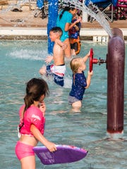 Young ones cool off and have fun at Love Municipal
