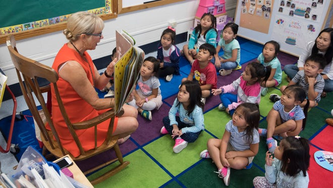 Former Florida First Lady Ann Scott reads to a group of pre-kindergarten students at the McMillian Pre-K Center in Pensacola on Oct. 2, 2017. The school board has voted 4-1 to transfer classes, teachers and support staff out of the center as a means of covering a district partner's$500,000 budget shortfall.