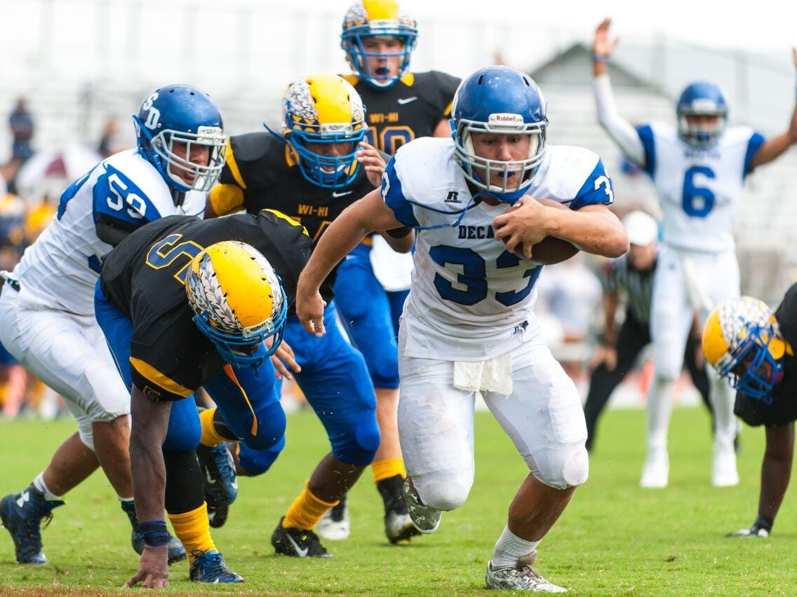 Stephen Decatur senior Dryden Brous scores a touchdown against Wi-Hi on Saturday. Brous has close to 300 yards and four touchdowns in two games but it's the offensive line he is thanking.