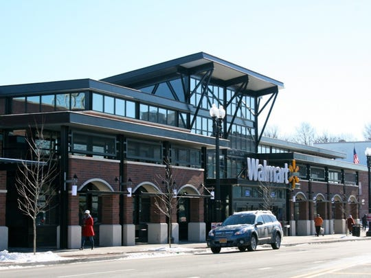 This Wal-Mart opened last December in Washington, D.C. The building abuts the sidewalk and parking is below.