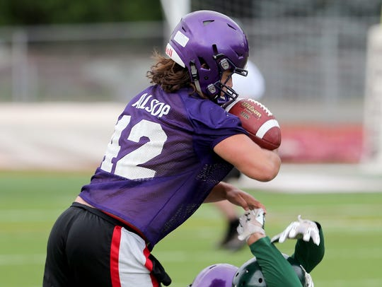 North Kitsap's Aiden Allsop makes an interception against