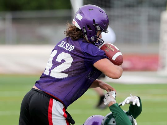 North Kitsap's Aiden Allsop makes an interception against Port Angeles 7 on 7 football at South Kitsap High School in Port Orchard on Wednesday, July 18, 2018.