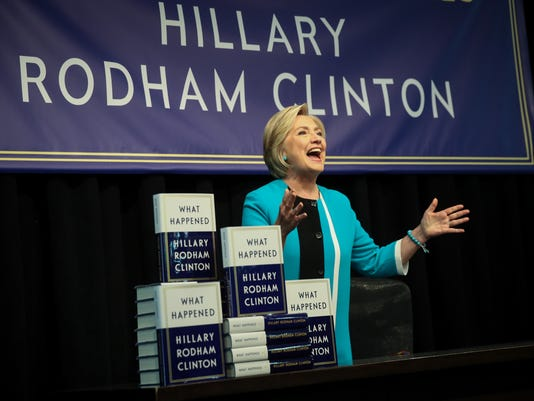 "*** BESTPIX *** Hillary Clinton Signs Copies Of Her New Book ""What Happened"" In NYC"