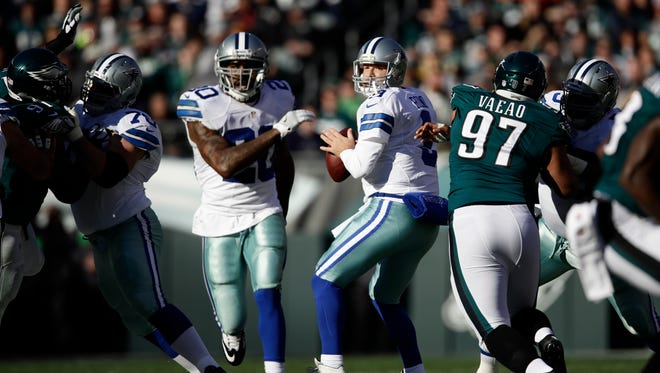 Dallas Cowboys' Tony Romo gets set to throw a pass against Philadelphia on Sunday. It was Romo's first appearance since he was hurt in the preseason.