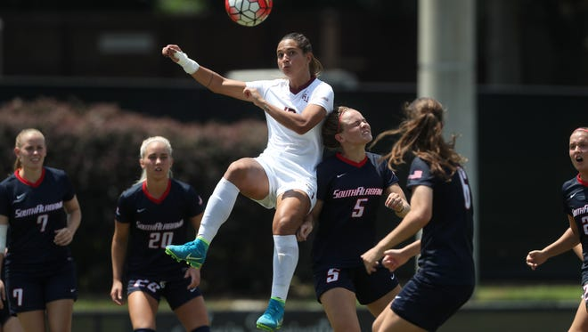 FSU's Deyna Castellanos leaps above South Alabama defenders for the ball at the Seminole Soccer Complex on Sunday, Aug. 20, 2017.