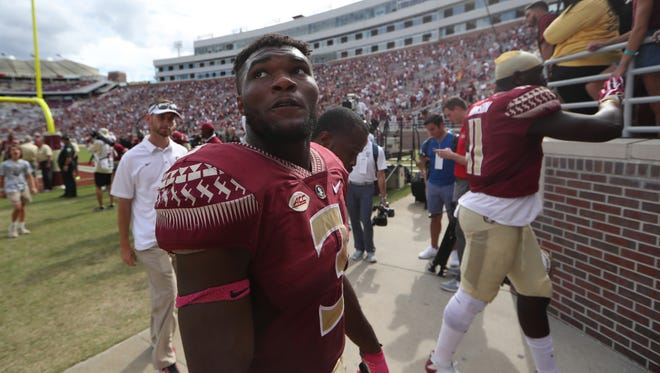 FSU's Cam Akers walks off the field after their 31-28 loss against Louisville at Doak Campbell Stadium on Saturday, Oct. 21, 2017.