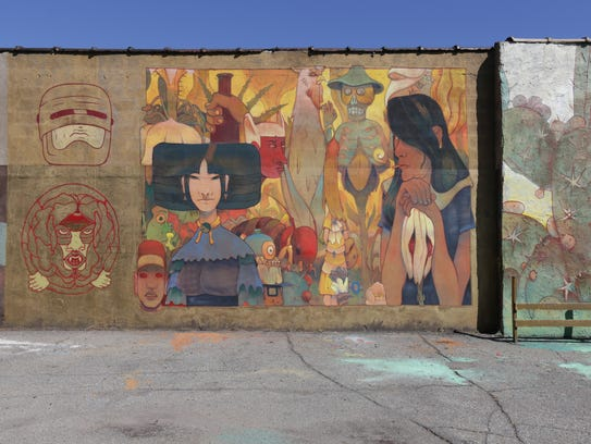 A mural by Jesus Benitez on the back of Garage Cultural