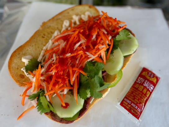 """A Vietnamese sandwich from FUSION, a Salem food truck thatspecializes in """"semi-authenticVietnamese"""" dishes."""
