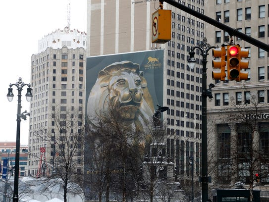 A MGM Grand lion sign can be seen from Woodward in