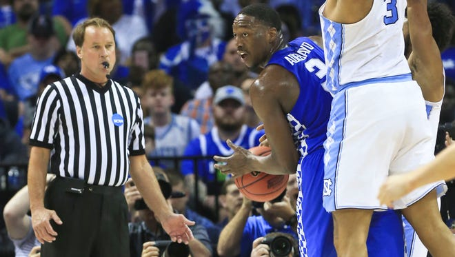 Referee John Higgins watches the play of Kentucky and North Carolina during the Elite Eight game at Memphis. The Tarheels beat the Wildcats 75-73, but some UK fans threatened the NCAA official via social media after the loss.