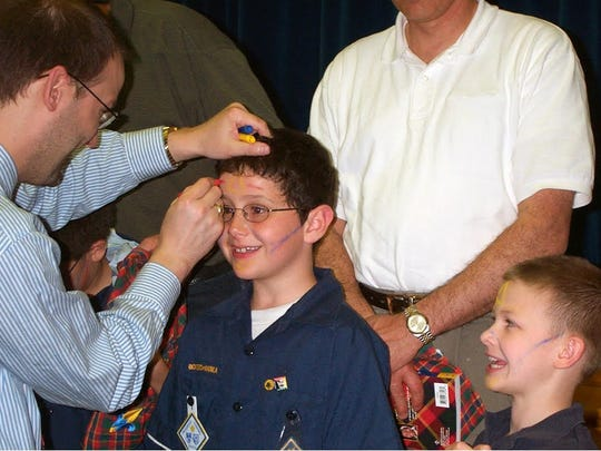 Craig Rideout, left, and Colin Rideout, right, at a Boy Scouts event.