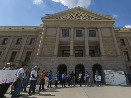 About 40 people gathered at the Arizona Capitol on