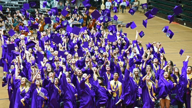352 graduating seniors from Ft. Collins High School celebrate at the conclusion of commencement exercises by throwing their caps into the air.  Saturday evening Ft. Collins High School was the last graduation ceremony for Poudre School District schools.
