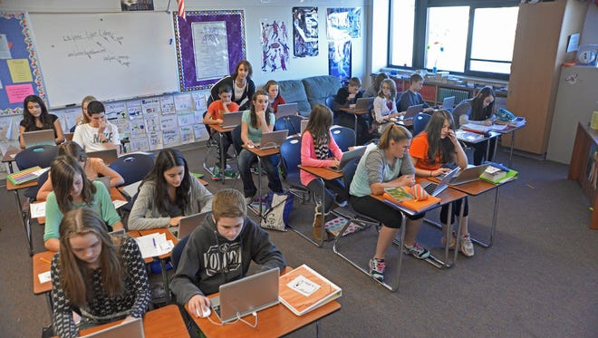 Severance Middle School seventh-grade students from an advanced language arts class study in this 2015 file photo.