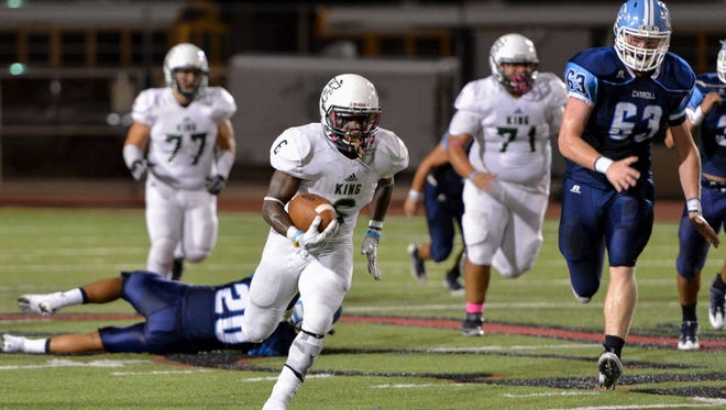 King's Adrian Walker (6) leads District 30-5A rushers with 1,213 yards and 14 touchdowns this season.
