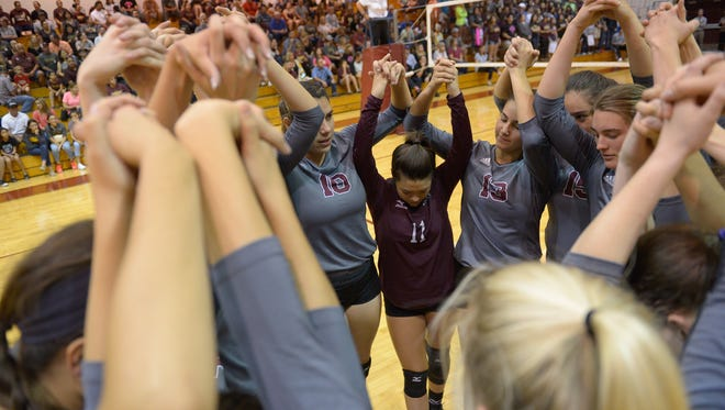 The Calallen Volleyball team huddles together before the start of a District 30-5A match against Tuloso-Midway on Tuesday, Oct. 25, 2016 at Calallen High School.