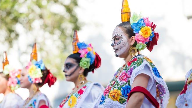 Victoria Fernandez, with Ballet Folkorico, performs Viva Mexico on Saturday, Oct. 29, 2016, during the Día de los Muertos Street Festival in downtown Corpus Christi.