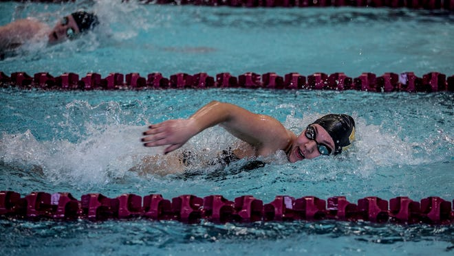 Kelsey Seas swim the freestyle in the medley relay for Watkins.