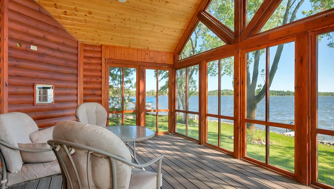 Just set back from the water's edge sits a three-season porch.