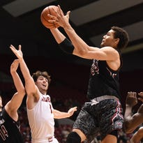 Feb 24, 2015; Tuscaloosa, AL, USA; South Carolina Gamecocks forward Michael Carrera (24) grasps a rebound over Alabama Crimson Tide guards Riley Norris (1) and Rodney Cooper (21) as well as teammate forward Laimonas Chatkevicius (14) during the second half at Coleman Coliseum. Alabama won 59-51.