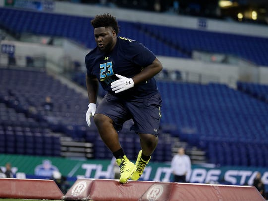 Mississippi defensive tackle D.J. Jones runs a drill at the NFL Scouting Combine on Sunday.