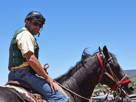 Trainer Wes Giles rides one of the horses he trains at Ruidoso Downs.